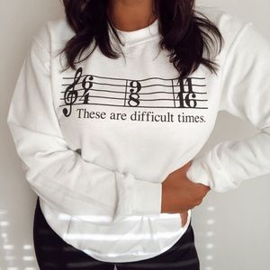 These are different times music note crewnecks